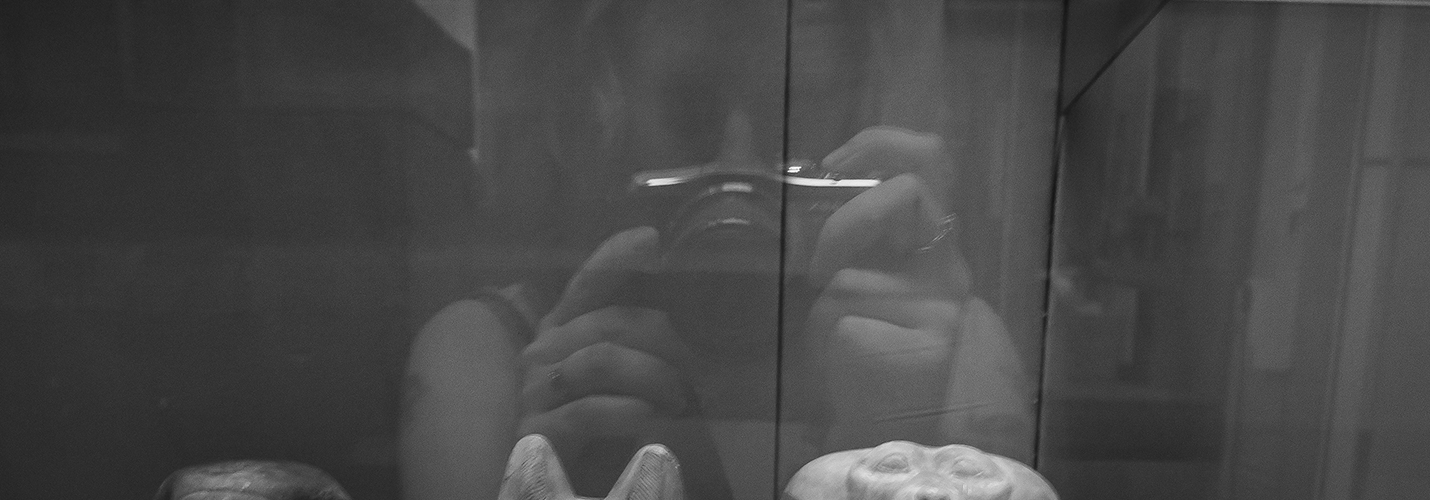 A reflection in glass of me and my camera