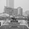 the king sits astride a horse with buildings disappearing into the mist behind it