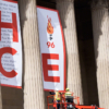 The last banner has a large 'e' and a logo of a torch with flame atop and the number 96 under it