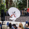 The whirling dervish photographed from further behind the crowds. He's spinning his removable skirt behind his head