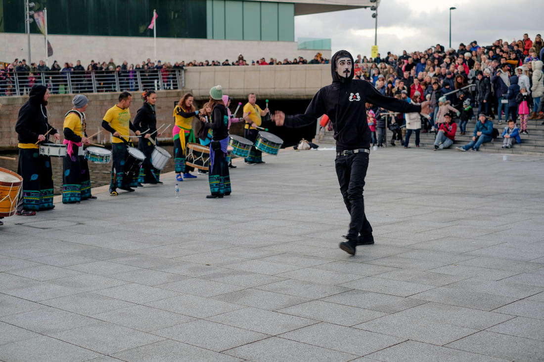 The dancer in front of the drummers again