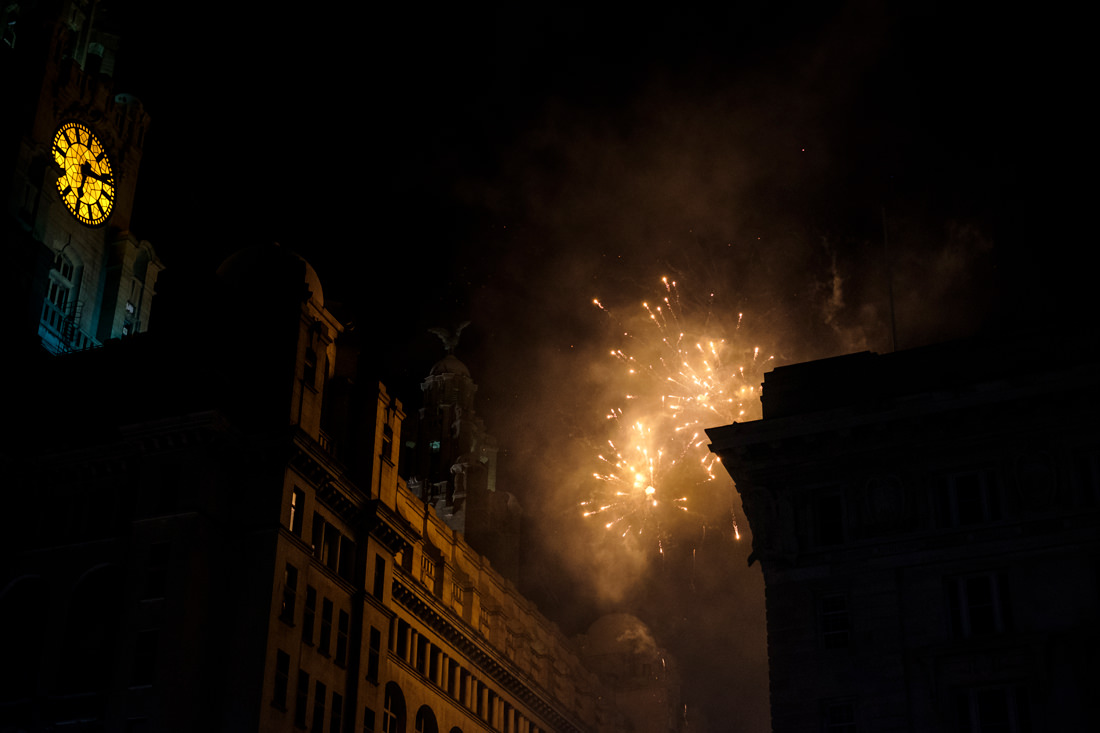 The side of the Liver Building lit up by a firework