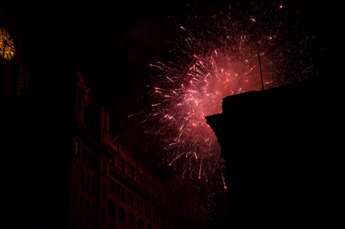 Fireworks going off by the Liver Building