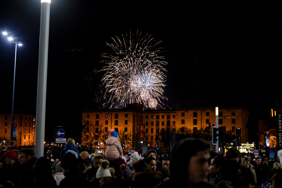 Fireworks exploding in the air behind the Albert Docks