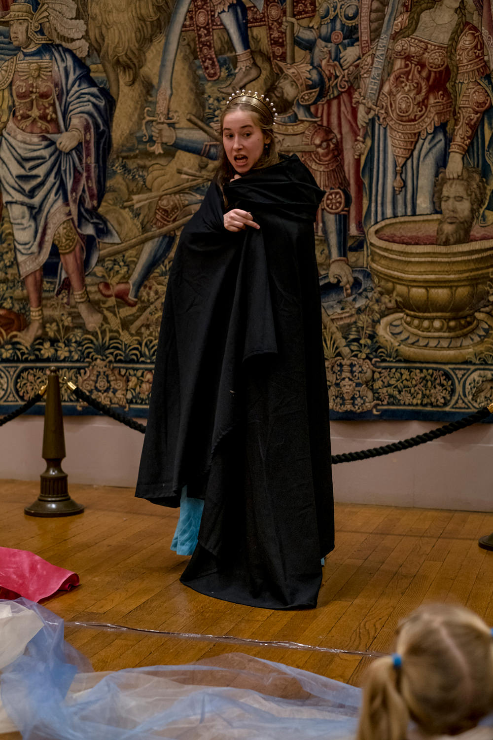 The actress wrapped in a black cloak