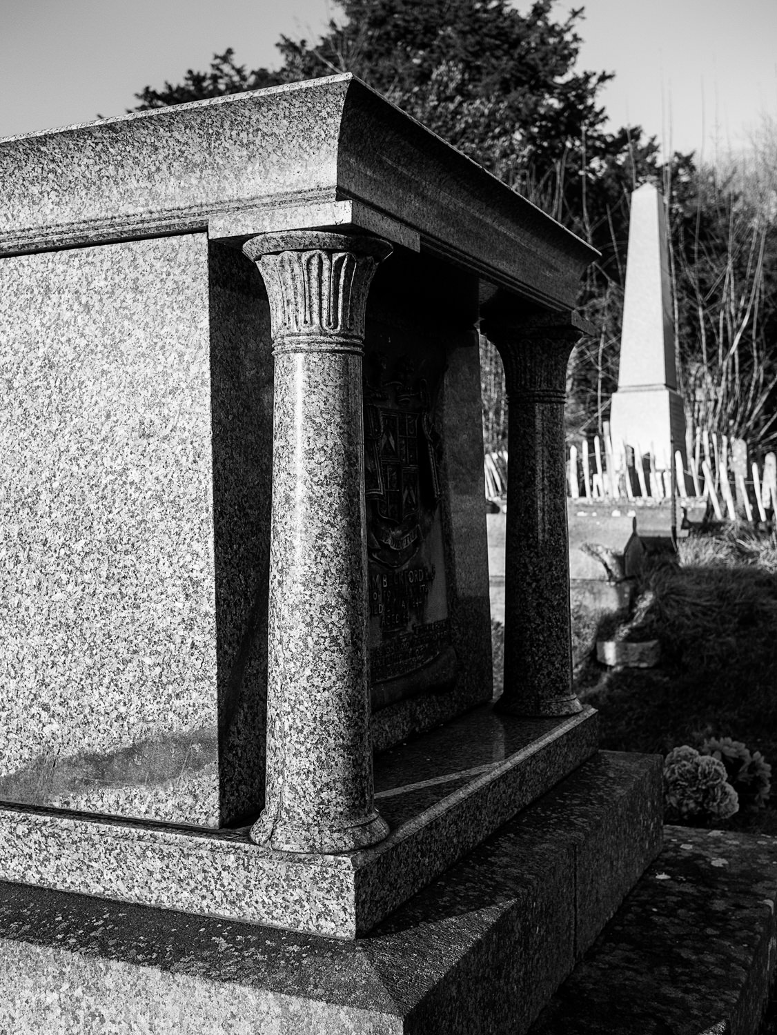 A closeup of one end of Beckford's grave. You can see two of the Egyptianesque pillars in detail. In the background is an obelisk-shaped grave.