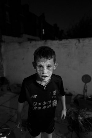 a boy with his face covered in flour