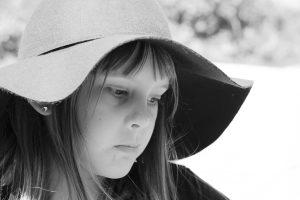 a girl wearing a wide-brimmed sun hat