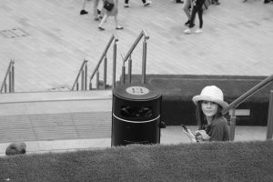 a girl sitting on a large set of outdoor stairs