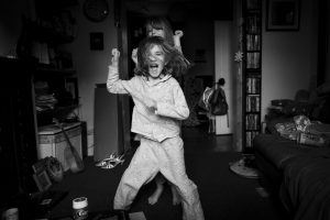 two girls dancing in a living room