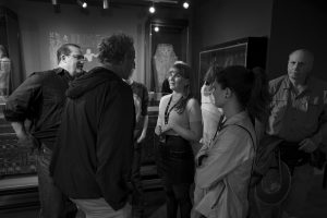 a group of people in a museum gallery