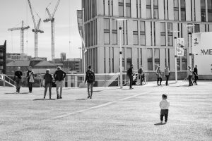 a toddler amongst shoppers at liverpool one