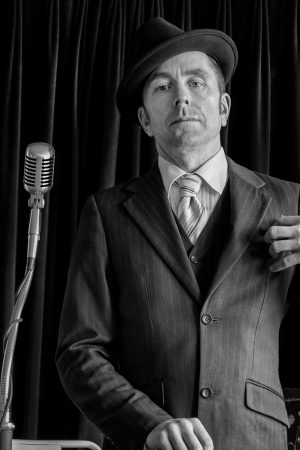 musician keith thompson dressed in a 1930s-style suit