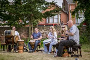 a group of drummers in a pub garden